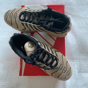 Cream and black air max shoes